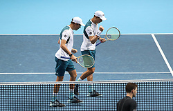 Bob Bryan (left) and Mike Bryan react during their doubles match during day two of the NITTO ATP World Tour Finals at the O2 Arena, London.