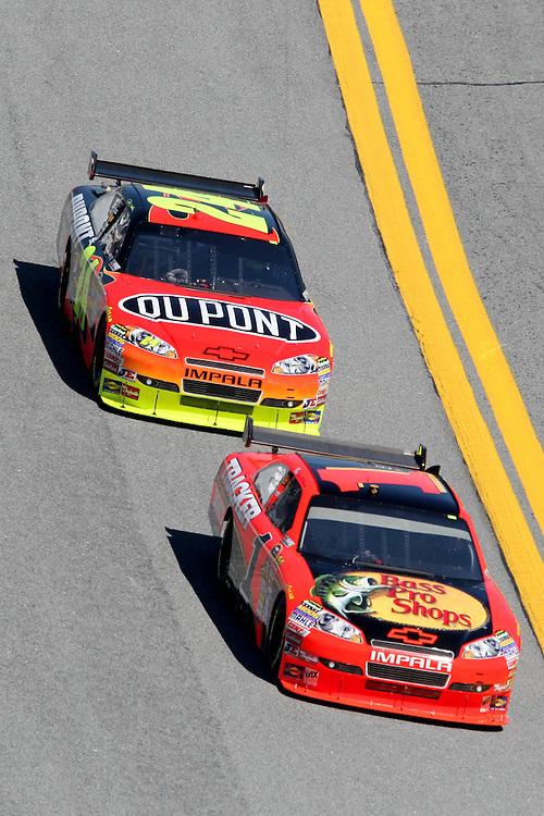 Feb 10, 2010; Daytona Beach, FL, USA; NASCAR Sprint Cup Series driver Jamie McMurray (1) leads Jeff Gordon (24) through the tri-oval during a practice session for the Daytona 500 at the Daytona International Speedway. Mandatory Credit: Douglas Jones-