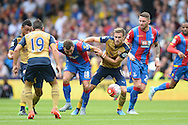 Aaron Ramsey of Arsenal pulls back James McArthur of Crystal Palace. Barclays Premier league match, Crystal Palace v Arsenal at  Selhurst Park in London on Sunday 16th August 2015.<br /> pic by John Patrick Fletcher, Andrew Orchard sports photography.