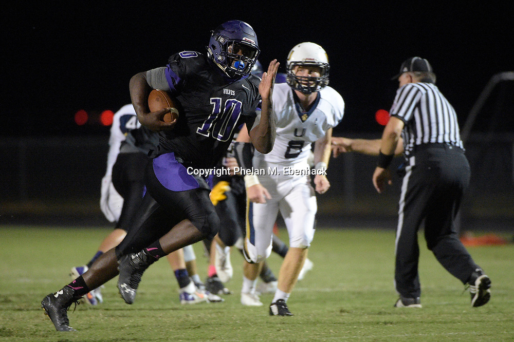 Timber Creek running back Jacques Patrick (10) rushes for one of his five touchdowns of the first half of a high school football game against University in Orlando, Fla., Friday, Oct. 17, 2014. (Photo by Phelan M. Ebenhack)