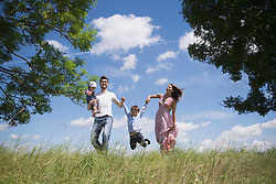 Happy family enjoying on meadow in the countryside, Bavaria, Germany
