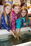 02/07/2017 REPRO FREE:  Laoise and Sarah Gavin,  and Kate Joyce from Moycullen  with a star fish at the explorers stand at Seafest 2017, the National Maritime Festival which  in Galway.<br /> . Photo:Andrew Downes, xposure .