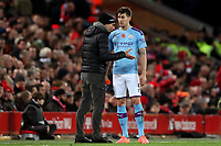 Football - 2019 / 2020 Premier League - Liverpool vs. Manchester City<br /> <br /> Manchester City manager Josep Guardiola speaks with John Stones during a break in play, at Anfield.<br /> <br /> COLORSPORT/PAUL GREENWOOD