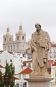 Sao Vicente da Fora church and a statue of San Vicente. City view. Lisbon, Portugal