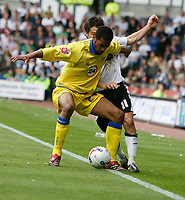 Photo: Steve Bond.<br />Derby County v Leeds United. Coca Cola Championship. 06/05/2007. Rui Marques holds off Paul Peschisolido