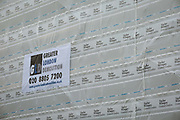 Detail of construction sheeting by Greater London Demolition on a site being cleared for the 10-storey luxury apartment development called The Denizen, a controversial building by Taylor Wimpey on Golden Lane that locals say will dominate their view and block their daylight, on 30th October 2017, in London, England. Despite this, they say We are one of the UKs largest residential developers. As a responsible developer we are committed to working with local people and communities.