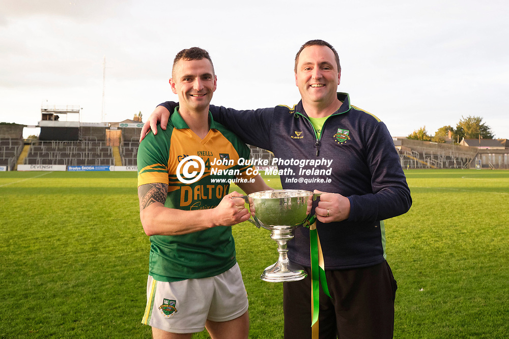 03/10/2020, IFC Final at Pairc Tailteann, Navan<br /> Trim v Ballinabrackey<br /> Ballinabrackey brothers Seamus & John Curry (Selector) pictured with the cup after they defeated Trim in the iFC final<br /> Photo: David Mullen / www.quirke.ie ©John Quirke Photography, Unit 17, Blackcastle Shopping Cte. Navan. Co. Meath. 046-9079044 / 087-2579454.<br /> FUJIFILM X-T3<br /> ISO: 800; Shutter: 1/250; Aperture: 4.5;