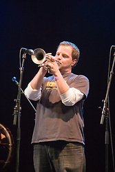 Member of Youngblood Brass Band playing a trumpet on stage at the WOMAD (World of Music; Arts and Dance) Festival in reading; 2005,