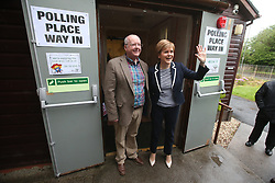 First Minister Nicola Sturgeon and her husband Peter Murrell leave after casting their votes in the General Election at a polling station at Broomhouse Community Hall in Glasgow.