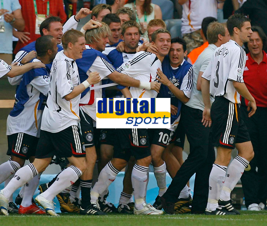 Photo: Glyn Thomas.<br />Germany v Sweden. Second Round, FIFA World Cup 2006. 24/06/2006.<br /> Germany's Lukas Podolski (C) is mobbed by his teammates after scoring his first goal.
