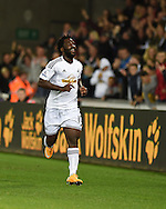 Swansea city's Wilfried Bony celebrates scoring his teams 2nd goal. Barclays Premier league match, Swansea city v Leicester city at the Liberty stadium in Swansea, South Wales on Saturday 25th October 2014<br /> pic by Andrew Orchard, Andrew Orchard sports photography.