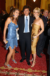 Left to right, FRANCESCA VERSACE, ANDY WONG, and CAROLINE HABIB  at a fashion show and dinner hosted by Shangri-la Hotels and Resorts and Andy Wong featuring fashion by new designer Lu Kun held at The Goldsmiths Hall, Foster Lane, London on 25th April 2005.<br /><br />NON EXCLUSIVE - WORLD RIGHTS