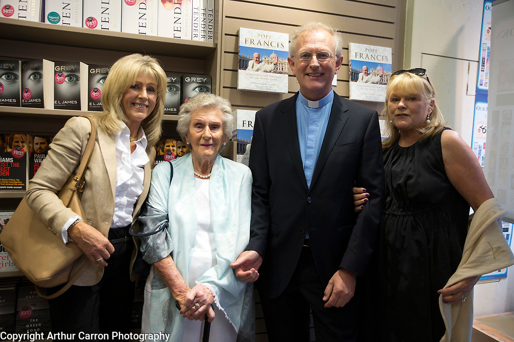 2/7/15 Fr Michael Collins with his sisters Paula Hickey and Geraldine McAlinden and mother Helen Collins at his book launch on Grafton Street, Dublin. Picture:Arthur Carron