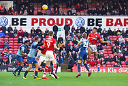 Jacob Brown of Barnsley (33) heads the ball from a corner during the EFL Sky Bet League 1 match between Barnsley and Wycombe Wanderers at Oakwell, Barnsley, England on 16 February 2019.