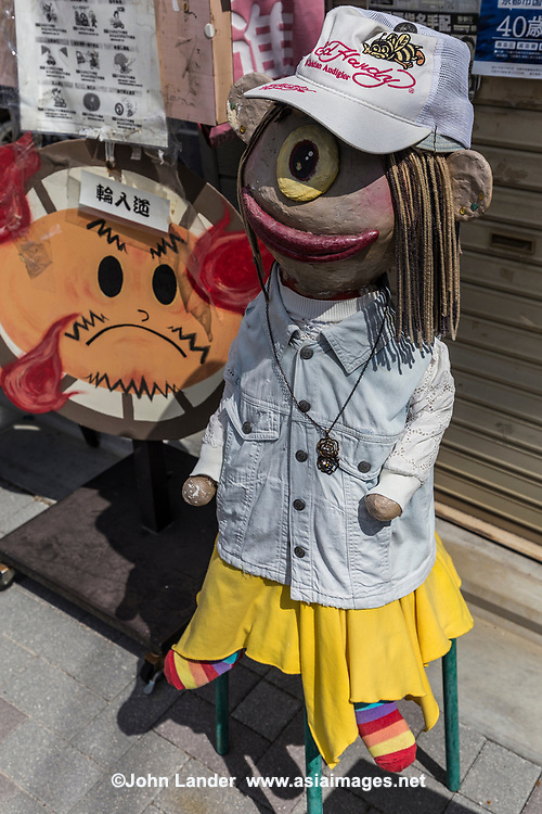 """Yokai Monster Street -  Yokai are a type of supernatural spirits or monsters.  In Japanese folklore, there is a wide range of yokai, ranging from amusingly mischievous to downright evil.  Some are humanlike, some are animals and others are inanimate objects that have come to life.  Officially Yokai Monster Street in Kyoto is Ichijo-dori, where more than thirty of these creatures have been created and decorate the small shops that they haunt.  Some of the yokai figurines are well crafted while others are haphazardly done.  You will see all the favorites:  kappa, tengu, tanuki plus quite a few others that are less familiar.  Monster art markets are held on the street, as well as a Yokai Monster Costume Parade every in October where these creatures really come to life! Yokai Street is the perfect antidote for visitors to Kyoto experiencing """"temple overload"""" and want something less sober."""