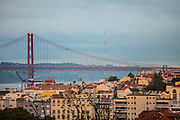 """The view from one f the balconies in one of the rooms at hotel """"Casa das Janelas com Vista"""", where 25th of April bridge  can be seen."""