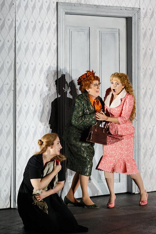 "LONDON, UK, 21 June, 2016. Left to right: Laura Wilde (as Jenufa), Natalie Herman (as Mayor's Wife) and Soraya Mafi (as Karolka) rehearse for the revival of director David Alden's production of Janacek's opera ""Jenufa"" at the London Coliseum for the English National Opera. The production opens on 23 June. Photo credit: Scott Rylander."