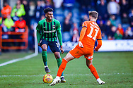 Coventry City defender Dujon Sterling (17) on loan from Chelsea, holds the ball from Luton Town midfielder Andrew Shinnie during the EFL Sky Bet League 1 match between Luton Town and Coventry City at Kenilworth Road, Luton, England on 24 February 2019.
