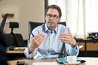 03 JUL 2019, BERLIN/GERMANY:<br /> Andreas Scheuer, CSU, Bundesminister fuer Verkehr und digitale Infrastruktur, waehrend einem Interview, in seinem Buero, Bundesministerium fuer Verkehr und digitale Infrastruktur<br /> IMAGE: 20190703-01-015