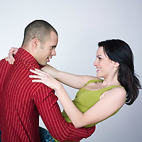 one young loving couple  dancing hug smiling portrait on isolated background man holding woman in his arms