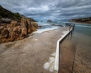 Editions of 17<br /> Storm rolls in on boat launch and ocean pool on the Australian Coast at the town of Tathra on the Sapphire Coast in the State of New South Wales