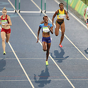 Athletics - Olympics: Day 13  Dalilah Muhammad of the United States winning the gold medal in the Women's 400m Hurdles with Sara Petersen of Denmark winning the silver medal at the Olympic Stadium on August 18, 2016 in Rio de Janeiro, Brazil. (Photo by Tim Clayton/Corbis via Getty Images)