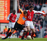 Photo. Daniel Hambury, Digitalsport<br /> Arsenal v Sheffield United. <br /> FA Cup Fifth Round.<br /> 19/2/2005.<br /> Arsenal's Robert Pires and Sheffield United's Leigh Bromby battle for the ball.