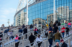© Licensed to London News Pictures. 18/04/2021. LONDON, UK. Spectators ascend the new steps outside Wembley Stadium ahead of the FA Cup semi-final match between Leicester City and Southampton.   4,000 local residents have been invited to attend the match, the largest number of spectators attending a match in a UK stadium for over a year.  Covid-19 testing will take before and after the match and data gathered will be used to plan how all sports tournaments can escape lockdown.  Photo credit: Stephen Chung/LNP