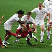 Manu Tuilagi, England, tackles Irakli Machkhaneli, Georgia, during the England V Georgia Pool B match during the IRB Rugby World Cup tournament. Otago Stadium, Dunedin New Zealand, 18th September 2011. Photo Tim Clayton...