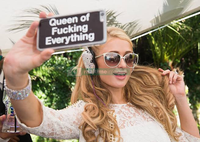 """Paris Hilton releases a photo on Twitter with the following caption: """"""""#TheAmericanMeme film streaming now on @Netflix. ✨👸🏼✨ #SelfieQueen 👑 https://t.co/IpyN6QTVZp"""""""". Photo Credit: Twitter *** No USA Distribution *** For Editorial Use Only *** Not to be Published in Books or Photo Books ***  Please note: Fees charged by the agency are for the agency's services only, and do not, nor are they intended to, convey to the user any ownership of Copyright or License in the material. The agency does not claim any ownership including but not limited to Copyright or License in the attached material. By publishing this material you expressly agree to indemnify and to hold the agency and its directors, shareholders and employees harmless from any loss, claims, damages, demands, expenses (including legal fees), or any causes of action or allegation against the agency arising out of or connected in any way with publication of the material."""