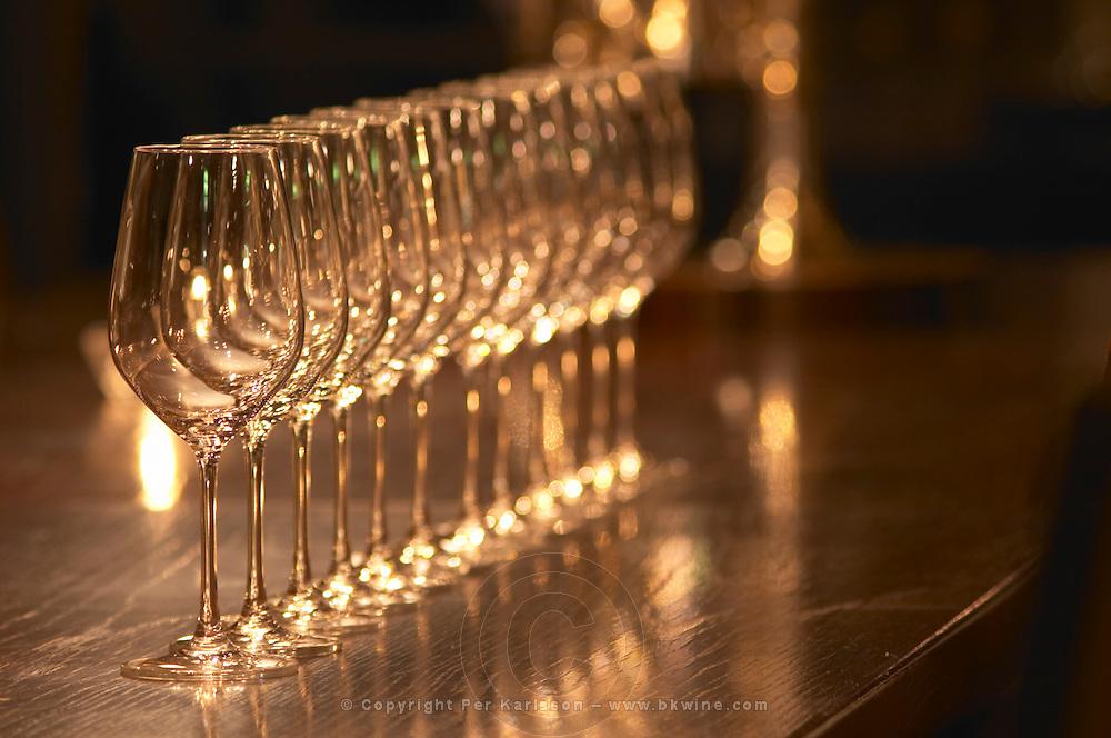 A straight row of wine tasting glasses lined up on a dark wooden table. Ulriksdal Ulriksdals Wärdshus Värdshus Wardshus Vardshus Restaurant, Stockholm, Sweden, Sverige, Europe