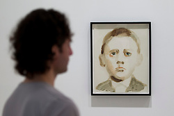 © Licensed to London News Pictures. 17/06/2013. London, UK. A Saatchi Gallery employee 'Adolf Hitler Germany' one of 29 portraits of dictators as children by French artist Annie Kevans at the press view for a new exhibition taking place at the West London based gallery. The exhibition, which runs from the 18th of June to the 29th of September 2013 at the Saatchi Gallery, is entitled 'Paper' and aims to challenge the viewers perceived ideas and expectations of the material in a world where its use is becoming rare thanks to emails and the internet  Photo credit: Matt Cetti-Roberts/LNP