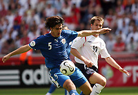 Photo: Chris Ratcliffe.<br /> England v Paraguay. Group B, FIFA World Cup 2006. 10/06/2006.<br /> Michael Owen of England clashes with Julio Cesar Caceres of Paraguay.