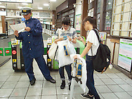 August 22, 2016 - Tokyo, Japan: At Tokyo's Harajuku Station, a large tree fell over due to high winds generated by Typhoon Mindulle, hitting the platform roof and an overhead cable. The tree, part of Meiji Shrine which borders the station, fell over mid afternoon and caused an immediate suspension of Tokyo's JR Yamanote Line, the major commuter that encircles the the city. Delays remained in place well into rush hour, much to the frustration of commuters already squeezed by other above ground commuter lines being halted. This typhoon, the ninth of this season, hit greater Tokyo and the outlying Kanto Plain area with the eye making landfall in neighboring Chiba Prefecture at around 12:30 p.m. Packing sustained winds of 126 kph (78 mph) and gusts as high as 180 kph (112 mph), Mindulle was the equivalent of a category 1 hurricane. It caused flooding as well as delays and cancelations to rail service including commuter lines, long distance express trains and the Shinkansen bullet train. In addition to rail disruption,s 244 flights were canceled at Tokyo's Haneda Airport. (Torin Boyd/Polaris).