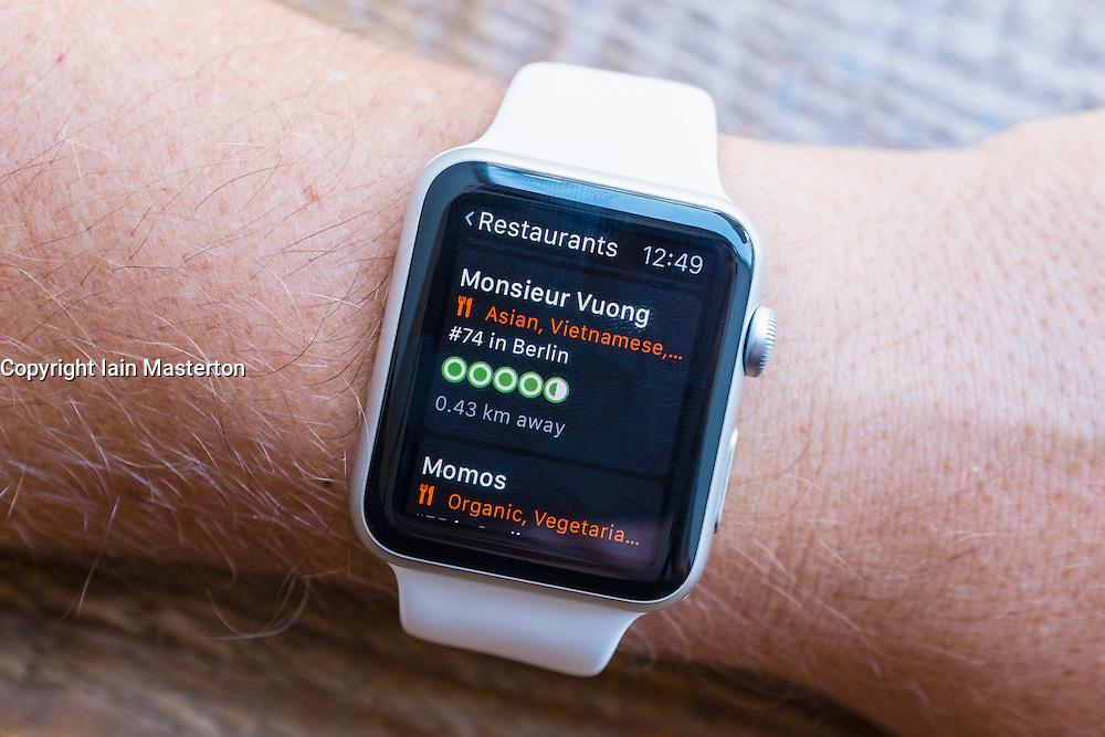 TripAdvisor app showing restaurants in Berlin on an Apple Watch
