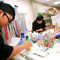 112712  Adron Gardner<br /> <br /> Gymanisha Livingston, left,  and Zerrika Joe work away on their gingerbread houses in Buffie Klumpenhower's University of New Mexico Gallup Center for Career and Technical Education class at Miyamura High School in Gallup Tuesday.