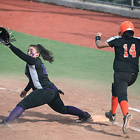 Gallup Bengal Adrieanna Stewart (14) runs safely to first base before  Miyamura Patriot Jennie Grijalva (18) slides in to a split to catch the ball while covering first base during the game at Ford Canyon Park in Gallup Friday.