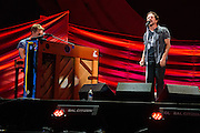 Photo of Eddie Vedder of the band Pearl Jam and Chris Martin of the band Coldplay performing live on stage at Global Citizen Festival in Central Park, NYC on September 24, 2016. © Matthew Eisman. All Rights Reserved