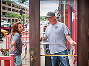31 MAY 2020 - DES MOINES, IOWA: TAMMY VANNONI, general manager of the Spaghetti Works, and FRANK SINGLETON, from Elite Glass and Metal, talk about the damage to Spaghetti Works, a popular restaurant in downtown Des Moines, after rioters shattered the windows. A group of rioters, protesting the death of George Floyd in police custody in Minneapolis, smashed windows in businesses and restaurants around the Polk County Courthouse in Des Moines. Des Moines police said they made 25 arrests Saturday night and very early Sunday morning. No one was hurt in the disturbances.       PHOTO BY JACK KURTZ