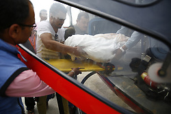 May 28, 2017 - Kathmandu, Nepal - Friends and family carry the body of the co-pilot who was killed along with a senior pilot (unseen) in the Goma aircraft crash while landing in foggy weather at Lukla Airport in Mt Everest region on Saturday afternoon in Kathmandu, Nepal on Sunday, May 28, 2017. (Credit Image: © Skanda Gautam via ZUMA Wire)