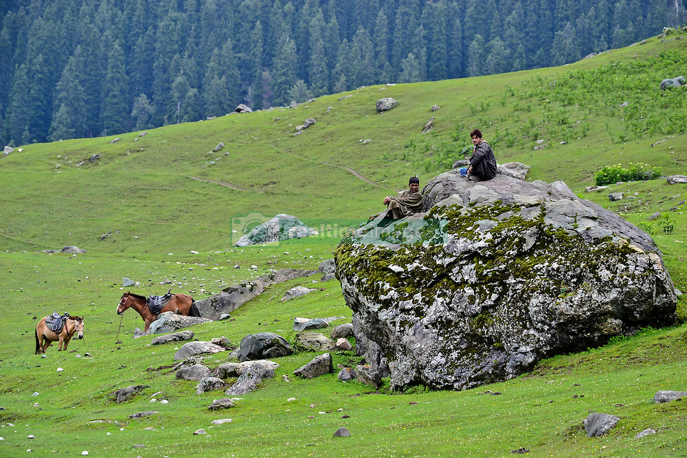 July 6, 2018 - Sonamarg, J&K, India - Pony riders wait for customers during the traditional journey to the Amarnath cave..Thousands of pilgrims annually go to the remote Himalayan shrine of Amarnath at 3,888 meters (12,756 feet) above sea level to worship an icy stalagmite representing Shiva, the Hindu god of destruction. (Credit Image: © Saqib Majeed/SOPA Images via ZUMA Wire)
