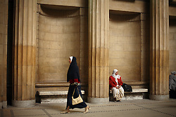 A woman waits in the central hall of the High Court in Cairo, Egypt on March 4, 2008. This is where many family court cases are often heard. Recently in the Muslim world, the reputation of Shariah law has undergone an extraordinary revival.