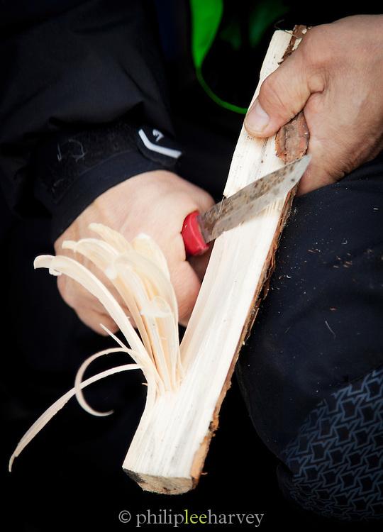 Making a Feather Stick for lighting fires, Lemmenjoki National Park, Finland