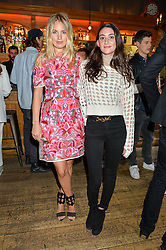 Left to right, MARISSA MONTGOMERY and LAUREN FASTENBERG at a quiz night hosted by Zoe Jordan to celebrate the launch of her men's ZJKNITLAB collection held at The Larrick Pub, 32 Crawford Place, London on 20th April 2016.