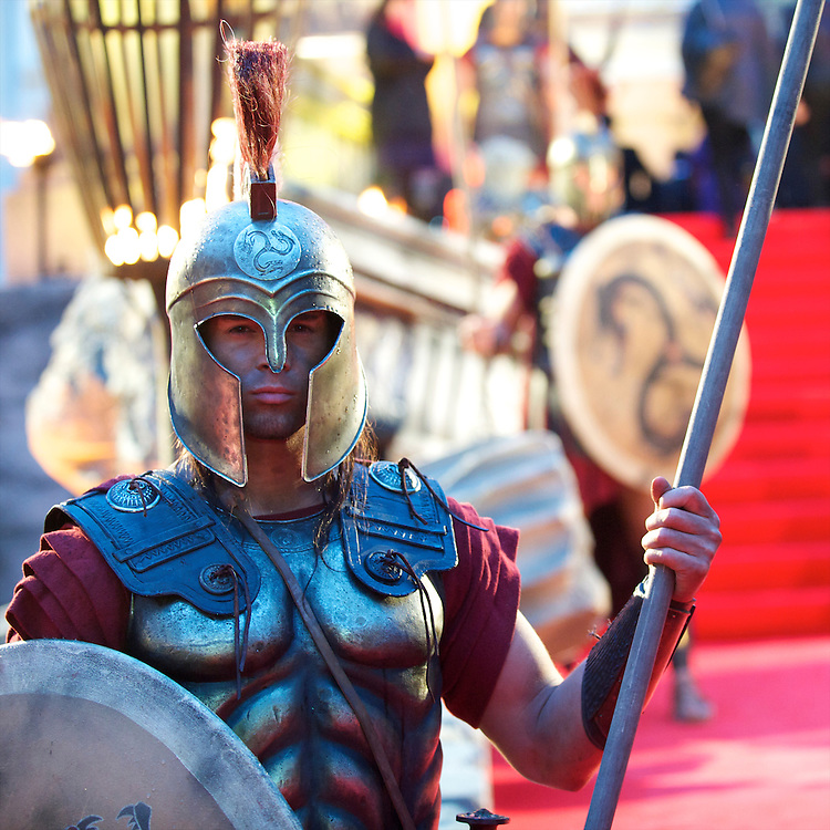 """A Greek sentry poses for a portrait at the world premiere of """"The Clash of the Titans,"""" a remake of the 1981 film, at Empire Leicester Square, London.  With a narrative inspired by the Greek myth of Perseus, Leicester Square was transformed into a ancient Greek setting, complete with a legion of soldiers, columns and scultpture ruins."""