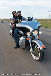Dawn Pollard with her husband and retired NBA player Scott Pollard (the two make 13' of fun!) on the annual Lichter/Sugar Bear Ride during the 75th Annual Sturgis Black Hills Motorcycle Rally.  SD, USA.  August 5, 2015.  Photography ©2015 Michael Lichter.