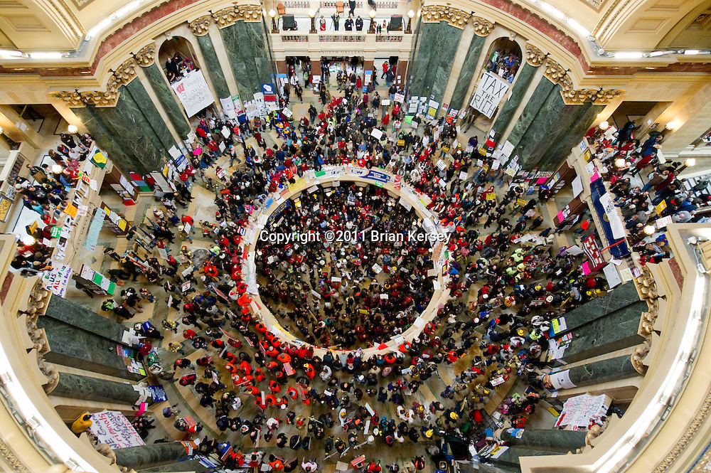 Protestors gather in the rotunda of the State Capitol on February 24, 2011 in Madison, Wisconsin. Protests over budget legislation continued for the 11th day as a bill proposed by Republican Gov. Scott Walker, which slashes benefits and revokes collective bargaining rights from state workers nears passage. (Photo by Brian Kersey)