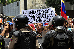 May 29, 2017 - Valencia, Carabobo, Venezuela - A young woman shows a sign that says ''your indifference makes me ashamed.'' Reacts '' , during the march for the education, against the constituent and the president Nicolas Maduro. Photo: Juan Carlos Hernandez (Credit Image: © Juan Carlos Hernandez via ZUMA Wire)