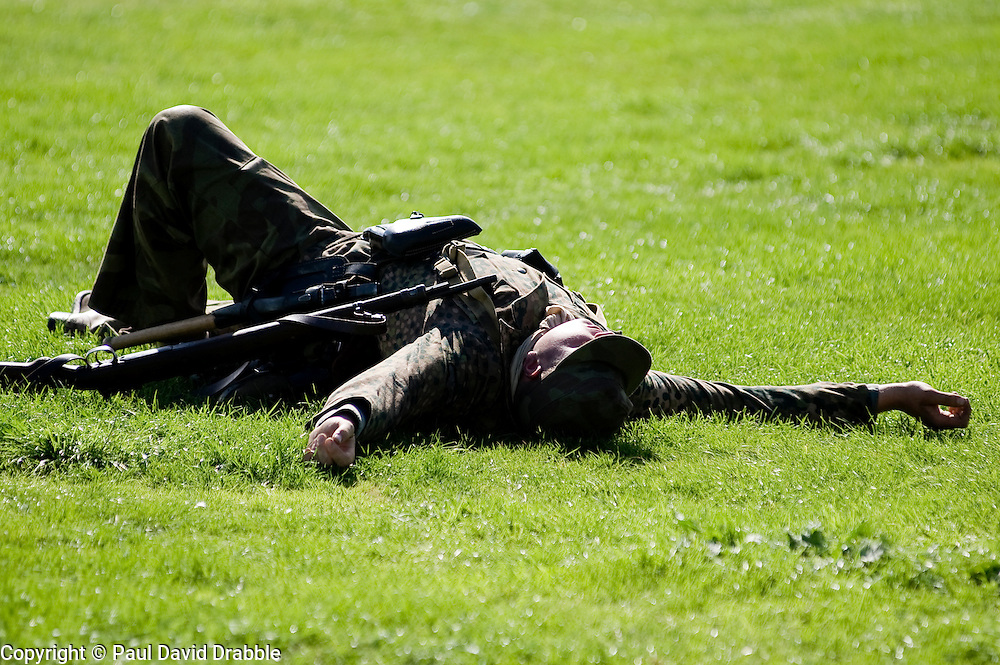 A reenactor portrays a German Panzergrenadier during a battle re-anactment at the The first Annual Lytham 1940s Weekend held to celebrate the 70th anniversary of the battle of Britain and raise funds for a new Fighter and Bomber Command Memorial to be erected in Lytham. 21 August 2010 Images © Paul David Drabble..