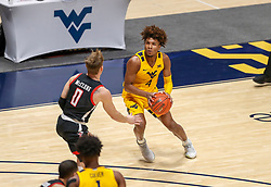 Jan 25, 2021; Morgantown, West Virginia, USA; West Virginia Mountaineers guard Miles McBride (4) sets to shoot a three pointer during the first half against the Texas Tech Red Raiders at WVU Coliseum. Mandatory Credit: Ben Queen-USA TODAY Sports
